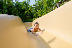 Boy Sliding Down Water Slide. Royalty Free Stock Photo