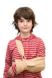 Boy with sling on broken arm. Isolated on pure white Stock Photos