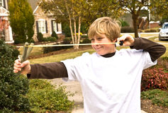 Boy with a Slingshot. Young boy shooting marshmallows in his slingshot royalty free stock photography