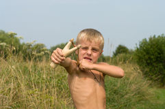Boy with a slingshot. Stock Photos
