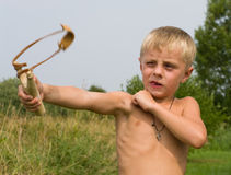 Boy with a slingshot. Stock Images