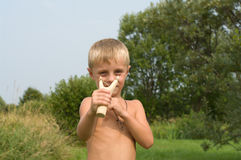 Boy with a slingshot. Royalty Free Stock Photo