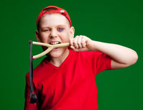 Boy with a slingshot Royalty Free Stock Images