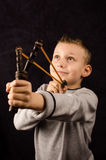 Boy with slingshot. Studio photo of a young boy with slingshot Royalty Free Stock Photos