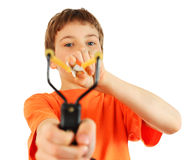 Boy with slingshot aim to camera Royalty Free Stock Images