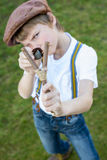 Boy with slingshot Stock Photography