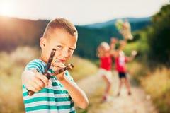 Boy with slingshot Stock Image