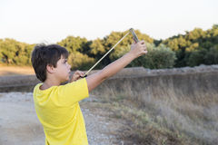 Boy with Slingshot Royalty Free Stock Image