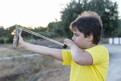 Boy with Slingshot Stock Images