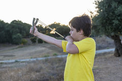 Boy with Slingshot Royalty Free Stock Photography