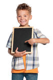 Boy with small blackboard Stock Photo