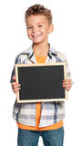 Boy with small blackboard Royalty Free Stock Images