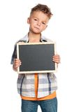 Boy with small blackboard Royalty Free Stock Photography