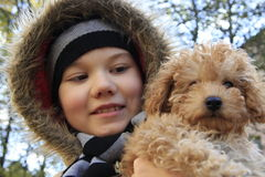 Boy with small dog. Just out from house, small boy with small dog, two good friends. In autumn and very cold day Royalty Free Stock Photo