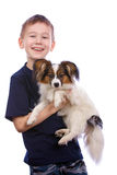 Boy and small dog Royalty Free Stock Photography