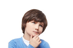 Boy small emotion kid think. Handsome brave cute small boy child kid express emotions cunning, tricky, sly, artful, crafty, wily ,reflect, meditate, think Stock Image