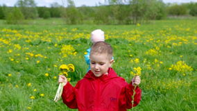 Boy and small girl  on meadow Royalty Free Stock Image
