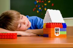 The boy with small house. From blocks Royalty Free Stock Photos