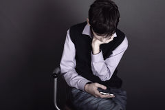 Boy with smart phone Stock Images