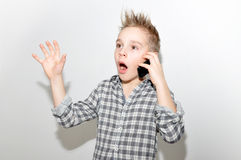 Boy with smartphone. Boy (ten years old) with smart phone, scared Stock Photography