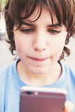 Boy with smartphone on street Royalty Free Stock Photography