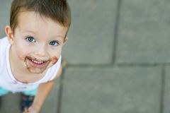 Boy smeared ice cream. dirty boy stock images