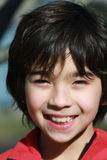 A Boy smiing. Portait of a 10 years old boy smiing naturally Royalty Free Stock Images