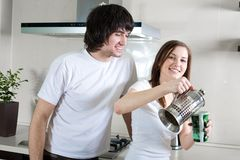 Boy with smile and girl with cup and with teapot Stock Photos