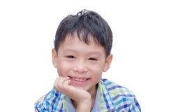 Boy smiles over white Stock Photos