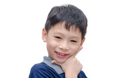 Boy smiles over white background Royalty Free Stock Images