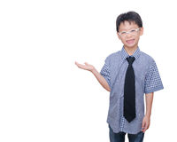 Boy smiles and showing space on hand Stock Photo