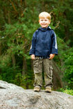 Boy Smiling. Little boy standing in the forest and smiling Royalty Free Stock Photography