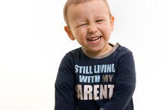 Boy smiling. Portrait of a sweet boy on white background Royalty Free Stock Images