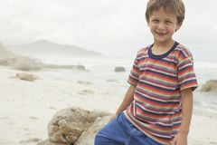 Boy Smiling On Beach Royalty Free Stock Photography