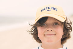 Boy smiling on the beach Royalty Free Stock Photo