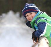 Boy smiling at camera. Boy wearing winter clothes smiling at camera Stock Photo