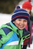 Boy smiling at camera. 6 year old boy wearing jacket and hat smiling at camera Stock Photo