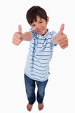 A boy smiling at the camera with the thumbs up Royalty Free Stock Images