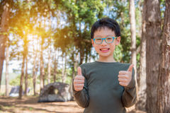 Boy smiling in camping site Stock Photo