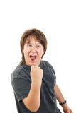 Boy smiling and confidently posing with fist up like success Royalty Free Stock Images