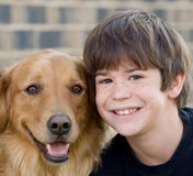 Boy Smiling With Dog. Cute Little Boy Smiling With Dog Stock Image