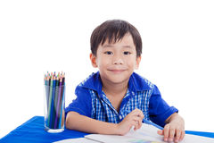 Boy smiling and drawing Stock Images
