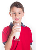 Boy smiling while drinking glass of milk Royalty Free Stock Images