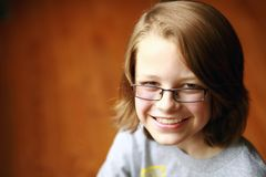 Boy smiling with eyeglasses Stock Photos