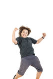 Boy smiling with face expression and jumping in black dark t-shi Stock Photo
