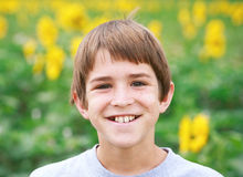 Boy Smiling in a Flower Field Stock Photo