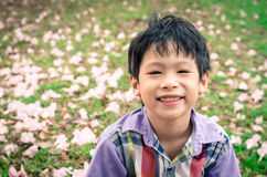 Boy smiling in garden Royalty Free Stock Image