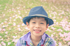 Boy smiling in garden Stock Photo