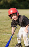 Boy Smiling Getting Ready to Hit. The Baseball Stock Image