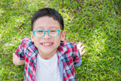 Boy smiling on grass field Stock Photos